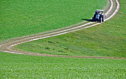 Tractor on a Crooked Road. Taken in Austria Royalty Free Stock Image