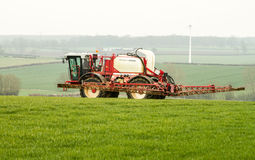 Tractor Crop Spraying in English fields Royalty Free Stock Photos