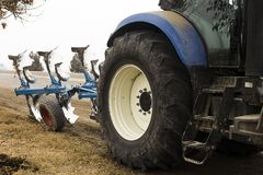 Tractor. Cropped image of modern farm equipment in field. Tractor.Cropped image of modern farm equipment in field stock photo