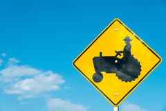 Tractor crossing sign with a sky blue background Stock Photo