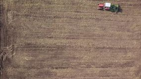 Tractor cultivates agricultural field for sowing. 4K video, 240fps, 2160p. stock footage