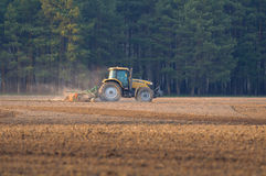 Tractor cultivates box spring. The spring agricultural fieldwork mechanized equipment Royalty Free Stock Image