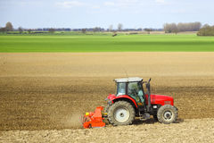 A tractor cultivating Royalty Free Stock Photos