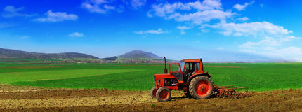 Tractor cultivating Stock Photo