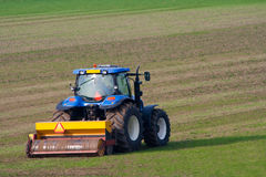 Tractor cultivating farmland Royalty Free Stock Images