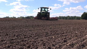 tractor cultivating farmland field soil stock footage