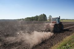 Tractor cultivating a field Royalty Free Stock Images