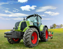 Tractor. Cultivating tractor in the field royalty free stock images