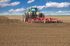 Tractor cultivating field Royalty Free Stock Image