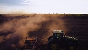 Tractor cultivating field at autumn stock video footage