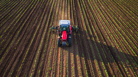 Tractor cultivating field at spring Royalty Free Stock Photography