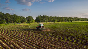 Tractor cultivating field at spring Stock Image
