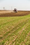 Tractor cultivating field at spring. Agricultural activity Stock Images