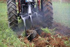 Tractor cultivating the field Royalty Free Stock Photo