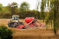 Tractor and cultivating machinery royalty free stock photo
