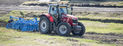 Tractor with cultivator handles field of agriculture Royalty Free Stock Photos