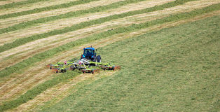 Tractor Cutting Grass Field with Hay Bob. Tractor Cutting Grass,Yorkshire, England Royalty Free Stock Photography