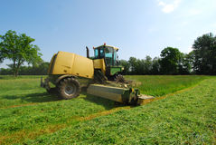 Tractor cutting grass meadow Stock Photo