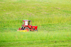Tractor cutting grass Royalty Free Stock Image