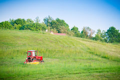 Tractor cutting grass Royalty Free Stock Photo