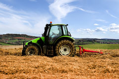 Tractor cutting hay. Photographed in Rural Cornwall, UK Royalty Free Stock Photo