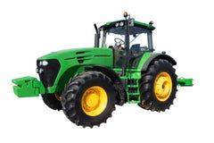 Tractor de granja con las ruedas grandes Fotografía de archivo libre de regalías
