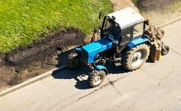 Tractor de la ciudad foto de archivo