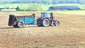 A tractor in Devon, England, getting ready to prepare the soil stock photography