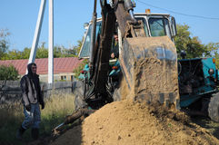 Tractor digging a hole with shovel Stock Photography