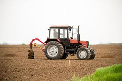 Tractor digging holes for tree planting Royalty Free Stock Photo