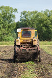 Tractor digging potatoes stock images