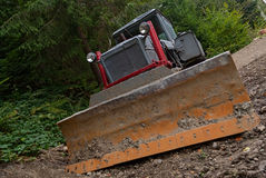 Tractor. Dirty tractor in the ground Royalty Free Stock Photography