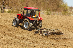 Tractor with disk harrow and rake Royalty Free Stock Photography