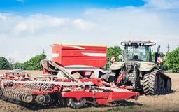 Tractor with drills on the field in Kiev region, Ukraine.  stock photography