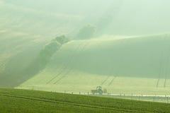 Tractor driven fertilizer Stock Image