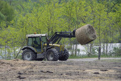 Tractor driven hay feeder Stock Photo
