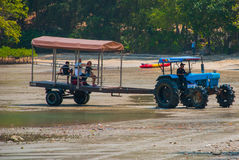 Tractor driven people. Peninsula of Railay. Krabi, Thailand. Royalty Free Stock Photography
