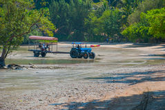 Tractor driven people. Peninsula of Railay. Krabi, Thailand. Royalty Free Stock Photo