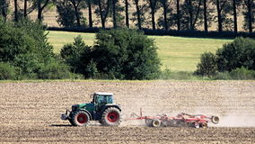 Tractor driver working in the field royalty free stock photo