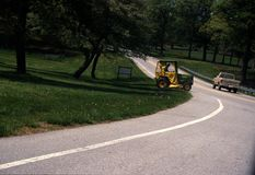 A tractor crosses over a road in Beltsville royalty free stock photos