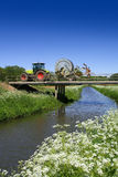 Tractor driving over bridge Stock Photos