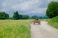 Tractor Driving on Rural Road Royalty Free Stock Photo