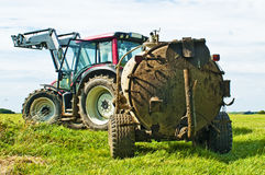 Tractor with dung Royalty Free Stock Image