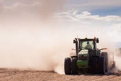 Tractor in a dusty dry farm Stock Image