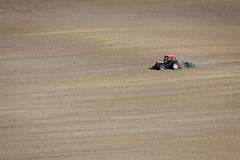 Tractor on dusty Field isolated Royalty Free Stock Photos