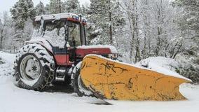 Tractor en la nieve Foto de archivo libre de regalías