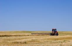 Tractor en Maaimachine Royalty-vrije Stock Afbeeldingen