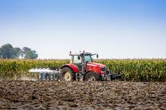 Tractor en Ploeg Stock Foto's