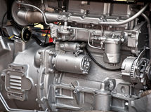 Tractor engine. Silver colored pipes and parts on a tractor engine Royalty Free Stock Photos