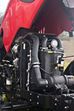 Tractor engine. New red tractor engine inspection Stock Image